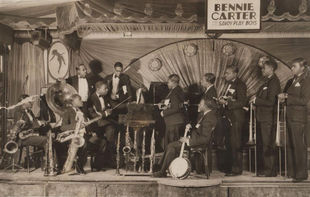1928 – Bennie Carter & His Savoy Playboys on the Savoy Ballroom bandstand. Source: Biblio.com